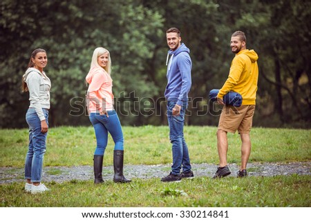 Happy friends on a hike in the countryside - stock photo