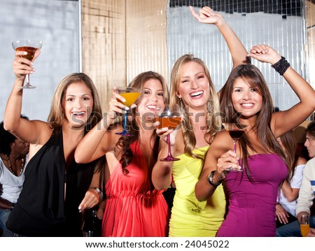 happy friends on a night out at a bar - stock photo