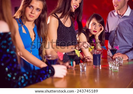 Happy friends on a night out together at the nightclub - stock photo