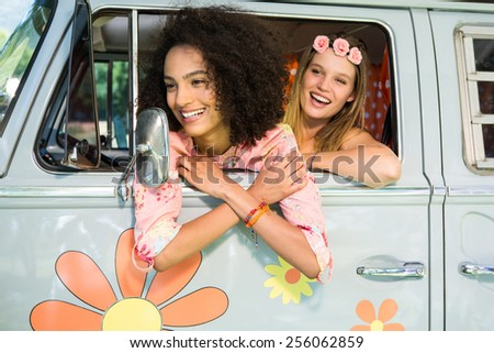 Happy friends on a road trip on a summers day - stock photo