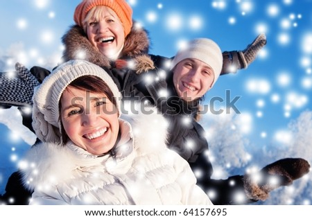 Happy friends on a winter background - stock photo