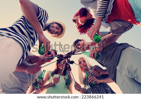 Happy friends on rest at beach - stock photo