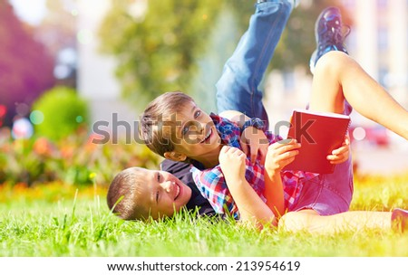 happy friends playing in park after school - stock photo