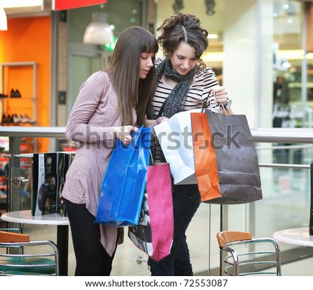 Happy friends showing clothes - stock photo