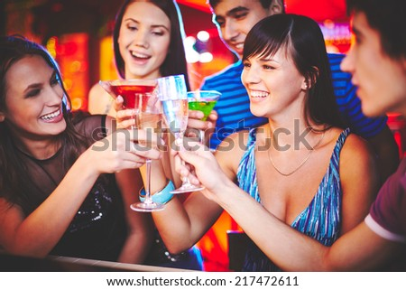 Happy friends with champagne cheering up at party - stock photo