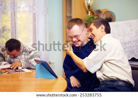 happy friends with disability socializing through internet - stock photo