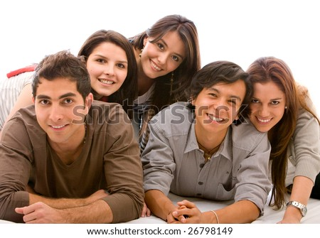 Happy friends with their heads together on the floor isolated - stock photo