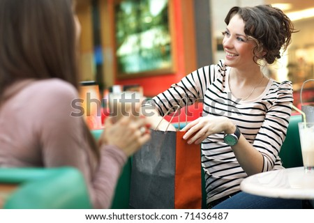 Happy frinds showing clothes - stock photo