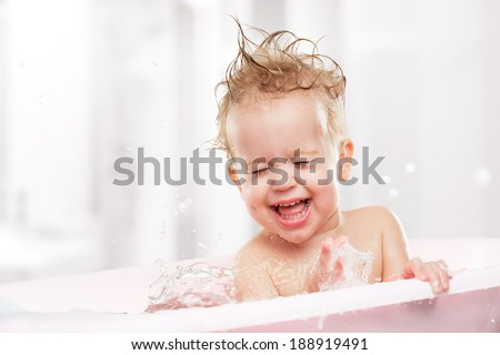 happy funny baby  laughing and bathed in the bath - stock photo