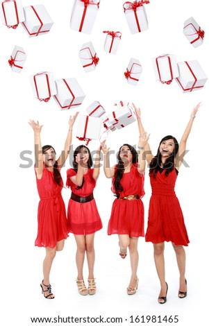 Happy funny beautiful women with boxes. Christmas. Party. Isolated over white background