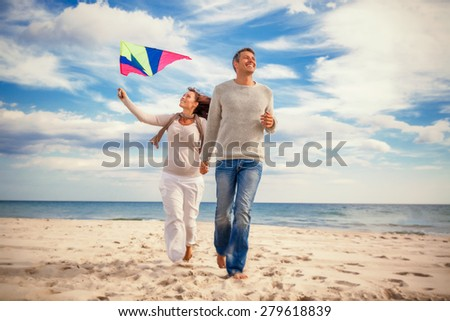 happy funny carefree couple enjoying freetime - stock photo