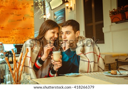 Happy funny couple in love having fun on a date in restaurant