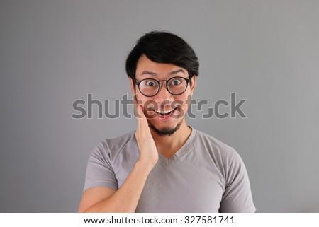 Happy funny face Asian man. - stock photo