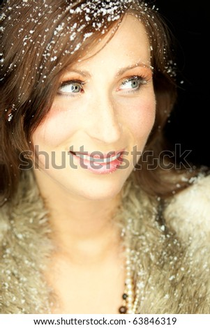 Happy funny female portrait looking snowflakes falling down  in december season