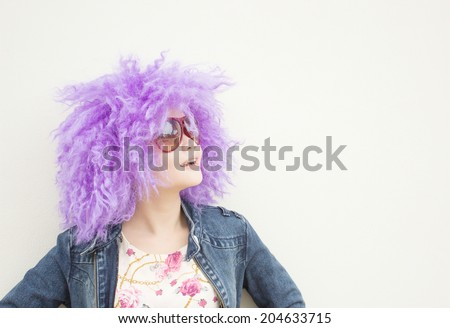 Happy Funny Girl With Purple Curly Wig Series,Copyspace For text And Ideas - stock photo