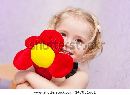 happy funny little girl with a flower