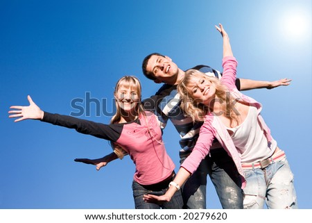 Happy funny people jumping end fly in blue sky - stock photo