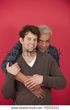 Happy gay couple in love on red background