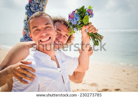 happy gay couple near the beach - stock photo