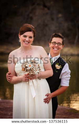 Happy gay couple standing together for civil union - stock photo