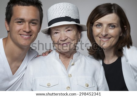Happy 3 generations family in white cloths. - stock photo