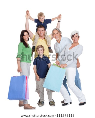Happy generations family with shopping bags. Isolated on white - stock photo
