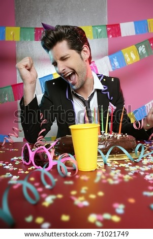 Happy gesture man in holiday party with chocolate cake - stock photo