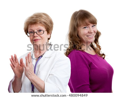 Happy gesturing doctor and laughing female patient behind, looking at camera, isolated on white background