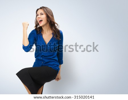 Happy gesturing young cheerful gesturing businesswoman, posing at studio - stock photo