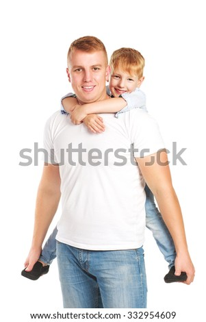 Happy ginger boy hugging his father isolated