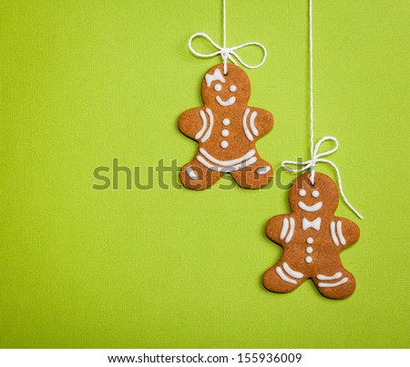 Happy Gingerbread People on Green - stock photo