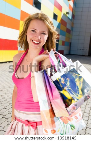 Happy girl after shopping - stock photo