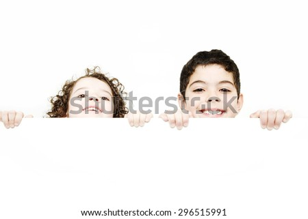 Happy girl and boy with board