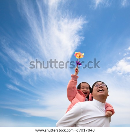 Happy girl and father with cloud  background - stock photo