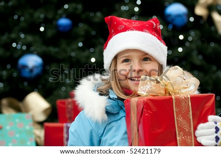 Happy girl at Christmas time - stock photo