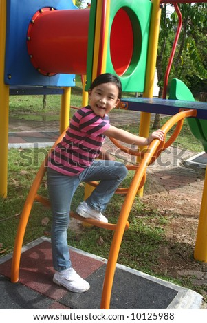Happy girl at the playground in the park