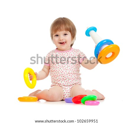 happy girl building pyramid on floor on white background - stock photo