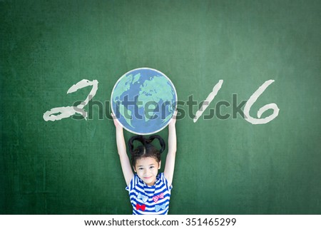 Happy girl child kid raising chalk drawing world globe w/ freehand writing text message new year 2016 seasonal celebration on green grunge chalkboard background celebrating year end and holidays   - stock photo