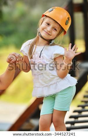 Happy girl climbing - stock photo