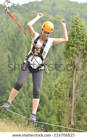 Happy girl climbing between tree  - stock photo