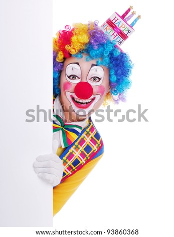 Happy girl clown in birthday cake hat holding the blank board - stock photo