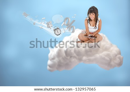 Happy girl connecting to cloud computing and accessing applications on blue background - stock photo