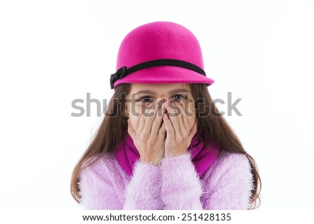 Happy girl covering her mouth with her hands - stock photo