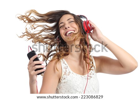 Happy girl dancing and listening to the music isolated on a white background - stock photo