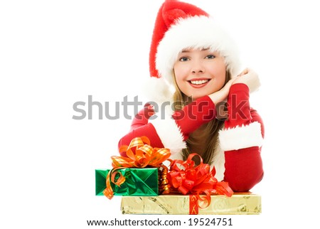happy girl dressed as Santa with Christmas presents - stock photo