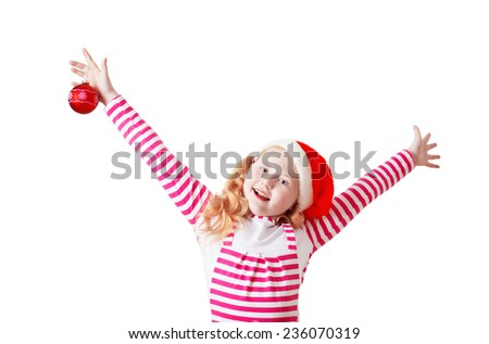 Happy girl dressed in Santa Claus hat - stock photo