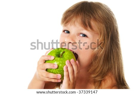 happy girl eating green apple; closeup
