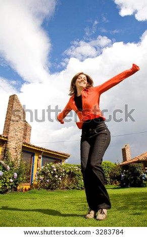 happy girl enjoying outdoors on a sunny day - stock photo