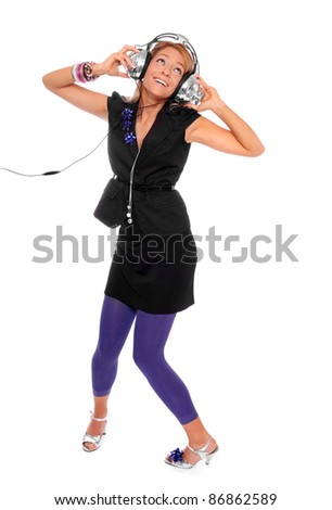 Happy girl enjoys listening music in headphones on a white background. - stock photo
