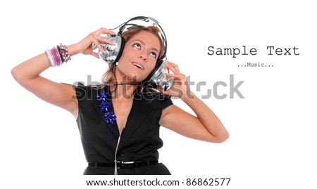 Happy girl enjoys listening music in headphones on a white background. Picture with space for your text. - stock photo